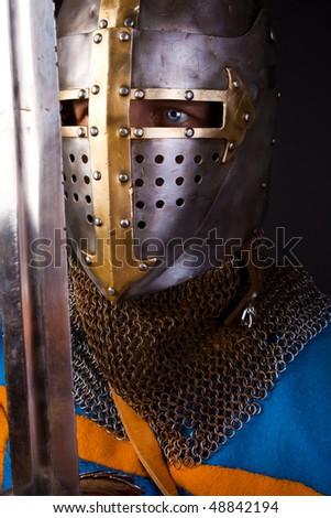 Picture of warrior in helmet - stock photo
