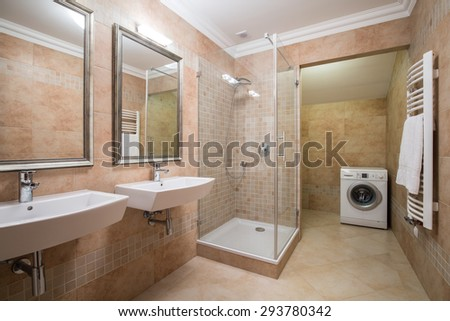 Picture of washing machine in beige bathroom - stock photo