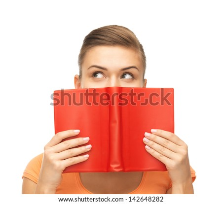 picture of woman eyes and hands holding red book - stock photo
