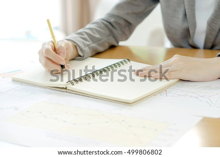 picture of woman hand with calculator and papers