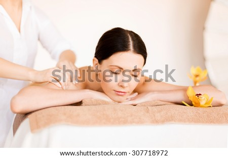 picture of woman in spa salon getting massage - stock photo
