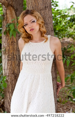 Picture of woman in white dress with creative bridal makeup outdoors