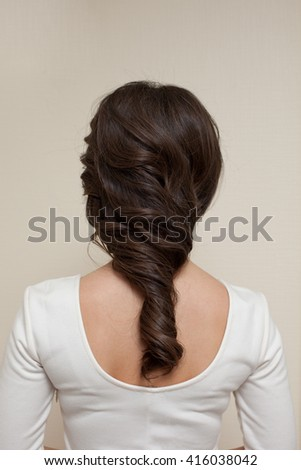 Picture of woman's back with hairstyle - stock photo