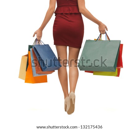 picture of woman's long legs with shopping bags. - stock photo