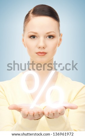 picture of woman showing sign of percent in her hand - stock photo