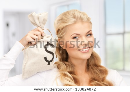 picture of woman with dollar signed bag - stock photo