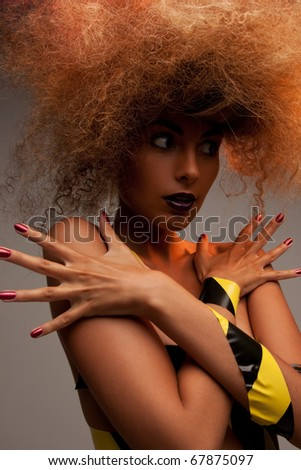 picture of woman with fashionable hair over grey - stock photo