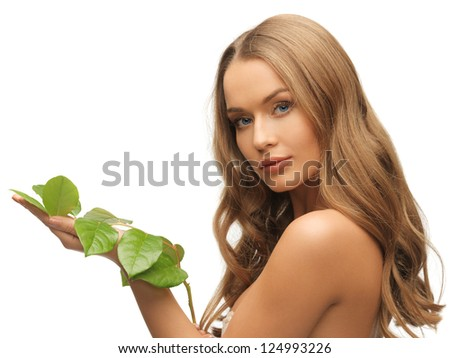 picture of woman with green leaf over white. - stock photo