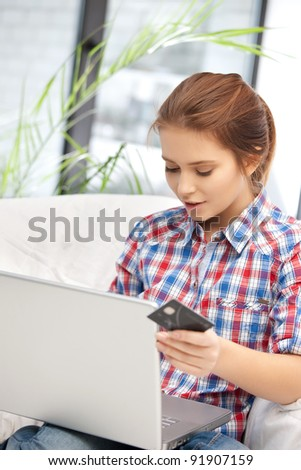 picture of woman with laptop computer and credit card - stock photo