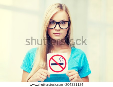 picture of woman with smoking restriction sign - stock photo