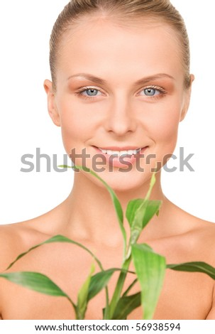 picture of woman with sprout over white - stock photo