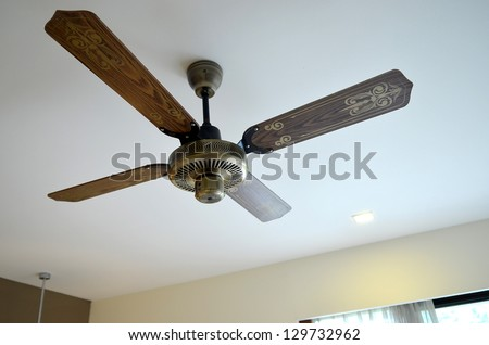 Picture of wooden ceiling fan inside the living room - stock photo