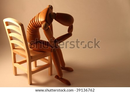 picture of worried dummy sitting with copy space - stock photo