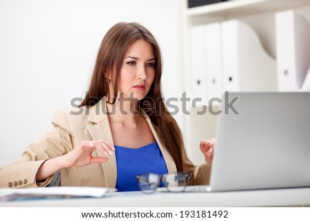 picture of worried woman with documents in office - stock photo