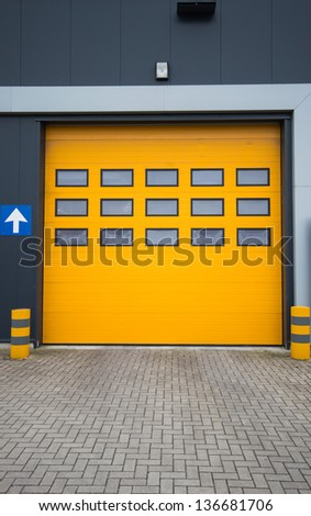 picture of yellow door in industrial warehouse - stock photo