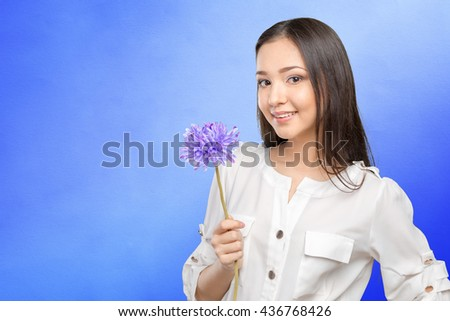 picture of young and beautiful woman with flower - stock photo
