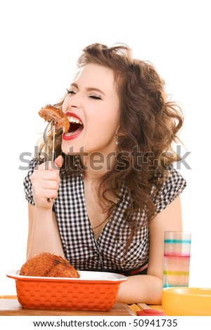 picture of young attractive woman in the kitchen - stock photo