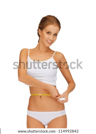 picture of young beautiful woman measuring her waist