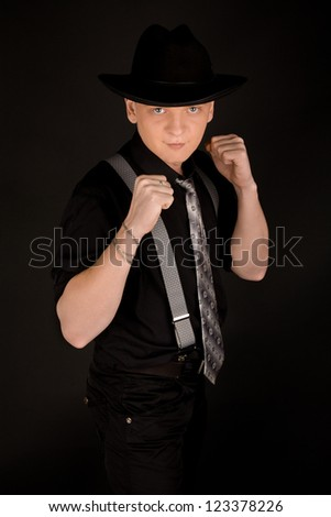 Picture of young boxing man in black - stock photo