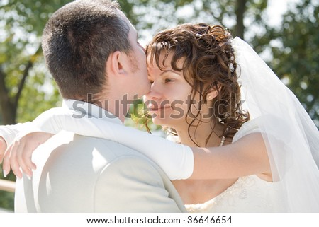 Picture of young bride and groom embracing