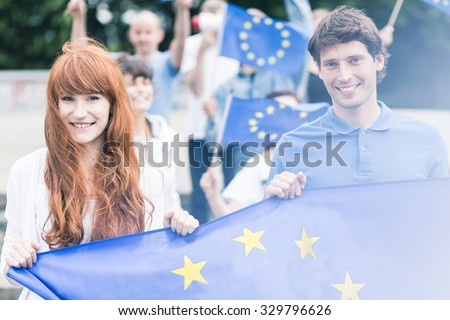 Picture of young community workers with european union flags - stock photo