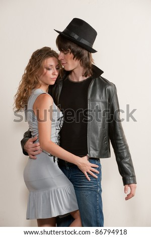 Picture of young couple, model posing in studio