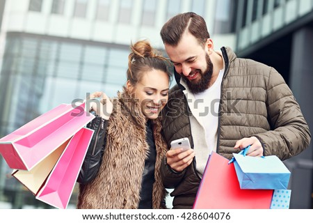 Picture of young couple with shopping bags in the city