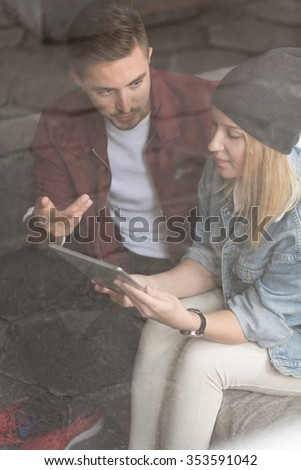 Picture of young creative pair of friends discussing