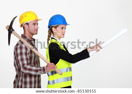 picture of young female architect with male bricklayer - stock photo