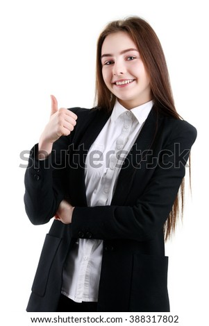 Picture of young female in black jacket showing thumb up, isolated on white background - stock photo