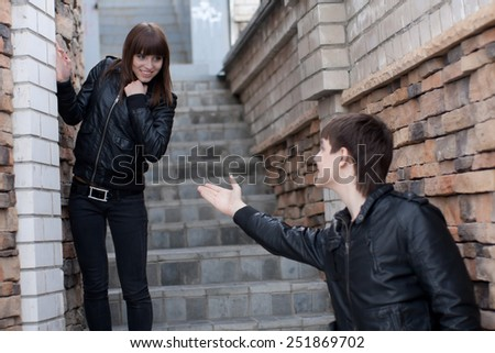 Picture of young man and woman outdoors - stock photo