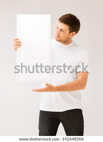 picture of young man holding white blank board - stock photo