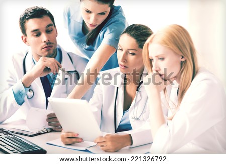 picture of young team or group of doctors working - stock photo