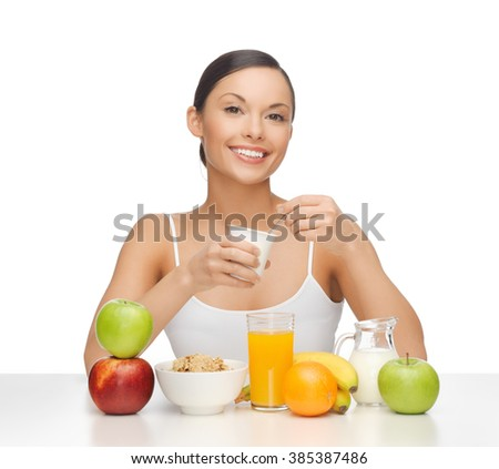 picture of young woman eating healthy breakfast - stock photo