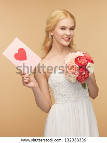 picture of young woman holding flower and postcard - stock photo