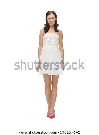 picture of young woman in white dress on high heels. - stock photo