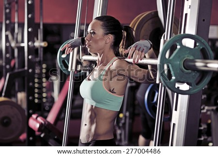 picture of young woman making exercise at the gym - stock photo