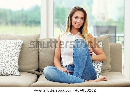 Picture of young woman on couch