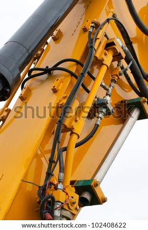 Picture on hydraulic connections of a excavator - stock photo
