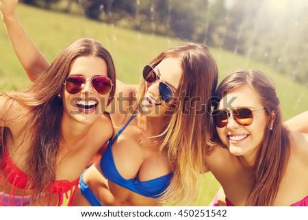 Picture presenting a group of women in bikin having fun outdoors - stock photo
