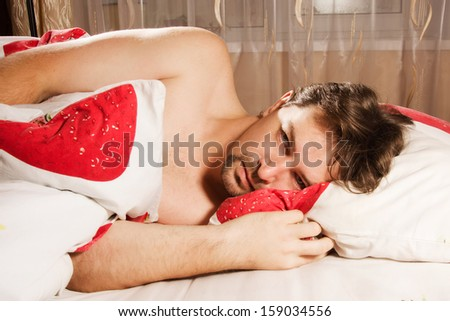 Picture with adult man relaxing  in bed