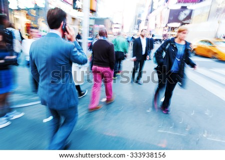 picture with camera made creative motion blur effect of business people and others walking in the city - stock photo