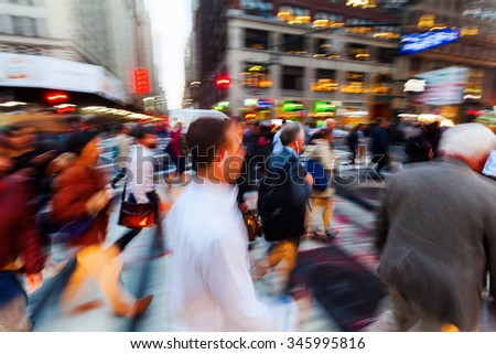 picture with camera made motion blur effect of crowds of people on the move on Broadway, Manhattan, New York City