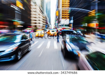picture with camera made zoom effect of a traffic scene in Manhattan, NYC - stock photo