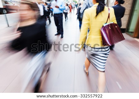 picture with creative zoom and blur effect of people walking in the city