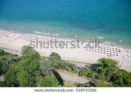 Pictures from the air. Bay with a beach, garden, shade the leaf against the blue sea - stock photo