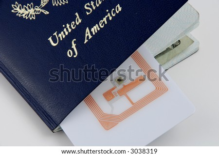 Pictures of a rfid tag embedded in a passport for safety purposes - stock photo