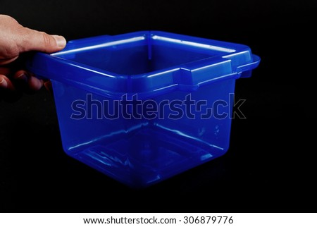 pictures of blue plastic clear containers for storage - stock photo