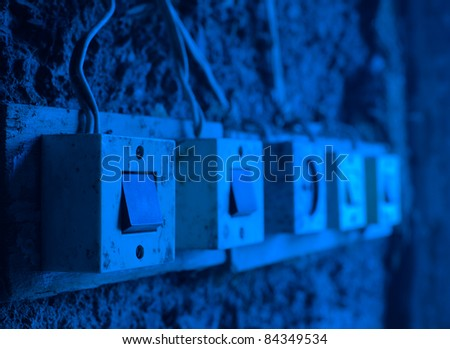 pictures of several old electrical switches - stock photo