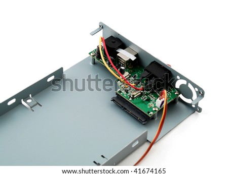 Pictures of the interior of a consumer electronics product showing the different components - stock photo